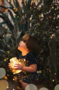 Child Holding Light